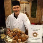 Baker Henry Roschek poses with his homemade apple fritters.