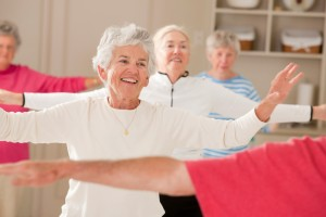 Seniors doing arm strengthening exercises in a health club