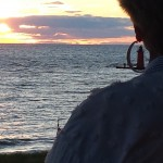 Capturing the South Haven lighthouse through the hoop of Donna's earring!