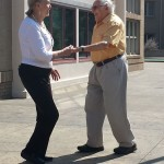 Deloris and Milt cutting a rug in the courtyard.