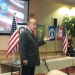 Retired Colonel Robert Henicky speaks to the Veterans.