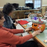 Residents get creative with pumpkins in the Town Center.