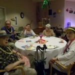Residents dressed in beach attire enjoying dinner.