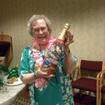 Nancy Mason takes home the prize for best dressed--a giant candy-filled champagne bottle!