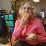 Kathleen demonstrating how to eat a slice of pizza!