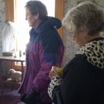 Residents visit a bedroom in the historic DeLano home.