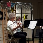 Residents Mary Ann Voss, Sue Gardner, and Mary Jo Strehlow treat the audience to a flute and clarinet piece.