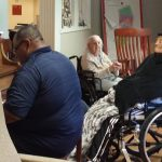Larry plays and sings for his mother and other residents in The Springs Lounge.