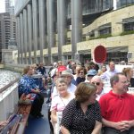 Residents, associates and family members on the upper deck of the Wendella boat, touring the Chicago River.