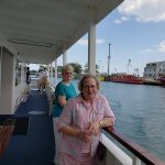 Two of our ladies enjoying the cruise from the lower deck balcony.