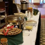 Ginger cookies, warm pretzels and cheese, and hot cider on the buffet.