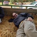 Our driver laying down in the hay for a short break!