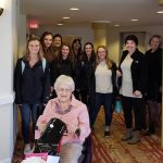 Resident Mary Ida Hunt leads the students to the Auditorium for the event.