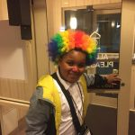 Young boy dressed as a clown.