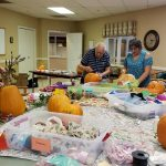 Pumpkin decorating in the Activity Room