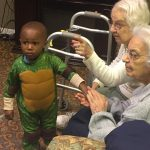 Ninja Turtle-clad child with Gardens residents