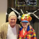 Resident couple as homeless man and a clown