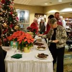 Residents help themselves to desserts by the 14 foot lobby Christmas tree