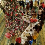 Overhead view of the lobby Christmas tree surrounded by dessert tables and guests.