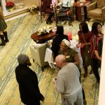 Overhead view of residents and associates mingling at the party