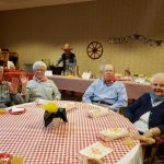 More residents hamming it up at their table.
