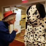Dalmatian getting a talking to by a Readers Theatre participant