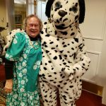 That Doggie in the Window Dalmatian poses with a resident--still dressed in her moo-moo from performing earlier.