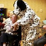 Dalmatian hugs a resident in the audience