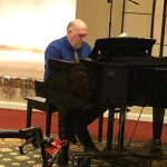 Housekeeping Director, Michael Rice plays piano