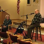 A resident sings a special song a Capella to his wife in front of the crowd.