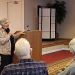 Resident Monique Coyne describes her experiences growing up in France for an audience of residents in the Town Center.