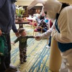 Easter Bunny greeting a young boy