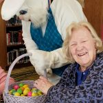 A very happy resident poses with the Easter Bunny