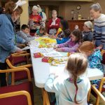 Children coloring and enjoying snacks at the Easter Egg Social