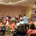 Full Kids in Tune orchestra playing for an enthusiastic crowd