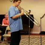 A young trombonist takes center stage for a solo