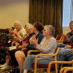 Gardens residents enjoying music from the band