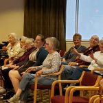 Another photo of residents having fun with music