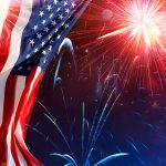 American flag with fireworks in the background